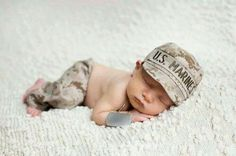©Adorable newborn photo of a marine parent.