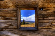Window of old abandoned cabin high up near Twin Lakes, Colorado with a view