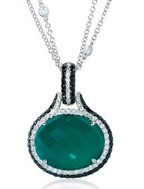 This magnificent 18k white gold pendant, features 1 oval cut green agate stone, of exquisite color, weighing 17.78 carats total with 61 round brilliant cut white diamonds of F color, VS2 clarity and excellent cut and brilliance weighing .46 carat total and 58 black diamonds, of exquisite color, weighing .81 carat total.