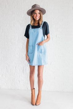 denim dress and navy tee shit with a tan hat and boots. Visit Daily Dress Me at dailydressme.com for more inspiration casual outfits, summer outfits, sunhat, booties, denim dress, women's tees, women's fashion 2018, summer outfits, bbq outfit