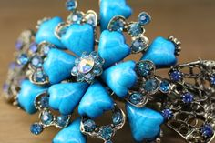 If youre looking for a vibrant, attention-grabbing hair accessory to spice up your look, this vintage barrette will do the trick! The bold Hair Barrettes, Hair Clips, A Little Life, Turquoise Gemstone, Hair Accessory, Spice Things Up, Night Out, Floral Design, Vibrant