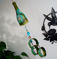 Wine bottle windchime,  Amber wind chime, Teal flowers, yard art, patio decor, recycled bottle wind chime, hand painted chime by LindasYardArt on Etsy