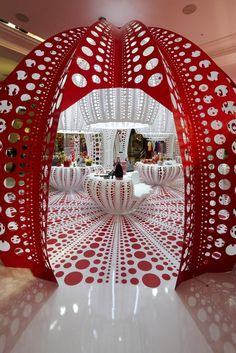 Unique red entry & floor design - Louis Vuitton's Kusama Pop-Up at Selfridges