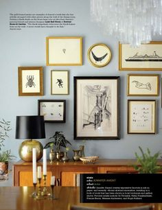 I like the way the various sized and shaped frames decorate this wall