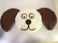 Easy dog birthday cake. 2 round cakes, 1 cut diagonally. Oreos split in half for eyes, the top of an Oreo for a nose and licorice for mouth!