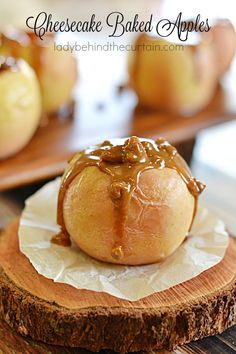 Cheesecake Baked Apples | Hollowed out apples, filled with cheesecake and topped with an easy to make caramel sauce.  The perfect dessert after a heavy holiday meal.