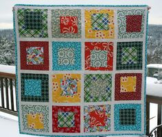 """Cluck Cluck Sew: Baby Boy Bug Quilt... I made it based on the tutorial on Amanda Jean's blog, based on Alissa's Land and Sea Quilt. I made my blocks 8"""" instead of 11"""" so I could fit more blocks in the baby sized quilt. I put some rough instructions below for making the wonky block. The back is the cute bug flannel that I love and is EXTRA warm and snuggely,"""