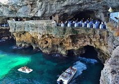 The Grotta Palazzese Summer Restaurant and it's located in a hotel by the same name in Polignano a Mare in the Puglia region of Southern Italy.