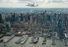 The Space Shuttle Enterprise, mounted atop a NASA 747 Shuttle Carrier Aircraft, is seen in this NASA handout photo as it flies near the Intrepid Sea, Air and Space Museum in New York April 2012 Space Shuttle Enterprise, Uss Enterprise, New Pictures, Cool Photos, Amazing Pictures, Inspiring Pictures, New York City Images, Skyline Von New York, Powerful Pictures