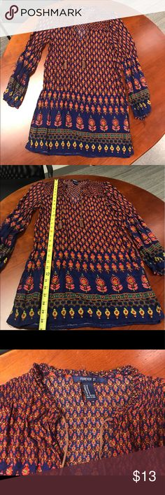 Forever 21 Colorful Patterned Long Sleeve Dress M Forever 21 Colorful Patterned Long Sleeve Dress with Brown Tassels. Size Medium. Loose strings hanging in various places but nothing that would effect the Dress! Forever 21 Dresses Long Sleeve