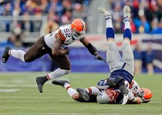 Cleveland Browns safety T.J. Ward (43) and linebacker D'Qwell Jackson (52) tackle New England Patriots tight end Rob Gronkowski