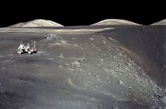 Apollo 17 astronaut on the rim of a lunar crater.