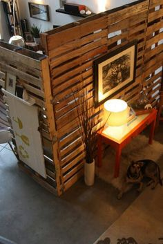 pallet room divider-Favorite! I can put one on each end to make it stand and put a rectangle piece of wood on the other side with chalkboard paint. Hang jacket hooks on the other side and set up a cute table like this...I can also do a family photo. On the opposite wall we can do the add to photo collage swirl