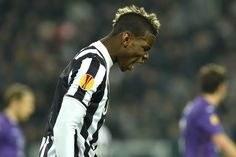 Paul Pogba of Juventus reacts during the UEFA Europa League Round of 16 match between Juventus and ACF Fiorentina at Juventus Arena on March...
