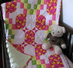 Bunches of Ducks - Gather up those rubber duckies and surround your baby in the soft comfort of this 100% baby flannel, unique, baby quilt in shades of pink with a dab of yellow and green.