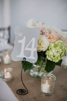 funky table number stand #tablenumbers http://www.weddingchicks.com/2013/11/25/big-bash-wedding/