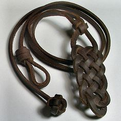A striking Spanish leather necklace for a man or a woman -- strong geometric shapes -- a Celtic powerhouse. The knotwork pendant on this necklace begins with a Crown knot and is followed by a sample of Celtic ocean weave. I created the necklace with a single dark brown Spanish leather thong. It is finished with a loop and diamond button knot closure. There is a loop at the bottom of the pendant that can be used with a simple jump ring to attach your own charms or decorative pieces. If you…
