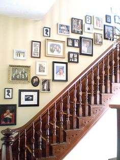 Staircase Photo Gallery I like all the different frames  colors and shapes... Great wood bannister & staircase, too!