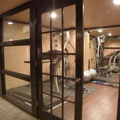 glass wall & doors b/t exercise room & playroom