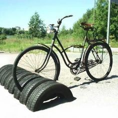 Very neat repurposing of old tyres - and less risk of damaging a disc brake compared to metal equivalents
