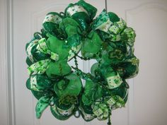 Big Bold beautiful Green St. Patricks Day wreath. Wreath features lots of Shamrock ribbon, Shamrock roping, green ribbon and green tubing. Glittery Shamrocks are featured in the wreath. The wreath is complete and ready to ship immediately!    Measures 26 in diameter    Check out all my wreaths    Special orders are always welcome.