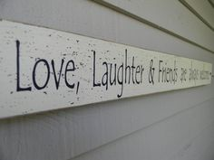 Love, Laughter & Friends are always welcome long narrow wood sign