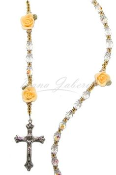 This beautiful Rosary is made from genuine glass faceted beads with an iridescent finish to provide an outstanding sparkle and silver findings. You may personalize this Rosary with up to 5 words and u