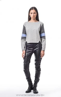 Warm and soft pullover from fleece jersey, with softshell and coated suiting on the sleeves. The textured insertions on the sleeves create a playful volume. Althought the sectioned design offers a sport-casual allure, the accessories and the styling can create a totally different story. The pop of color makes the item stand out.