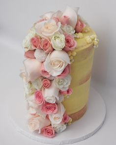 I am SO excited that I finally got the chance to do a floral waterfall. Amazing! Six layers of white coconut cake filled with key lime curd and frosted in coconut Swiss meringue buttercream. #roses #homebaker #undiscoveredbaker #cakeboss #cakeporm #bakeninja #minnstagrammers #cake #dessert #pink #freshflowers #wedding #weddingcake #bridalshower #babyshower #cakelife #nakedcake #seminakedcake #buttercream #hellogorgeous #coconut