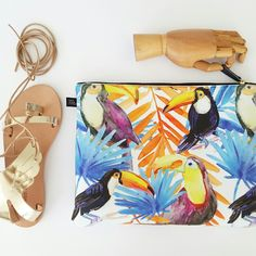 Do you wear tropical prints with your chic gold sandals? We say yes! Neoprene toucan print pouch and Icaria golden winged sandals are a match made in heaven #lovefromcyprus #tropicalvibes
