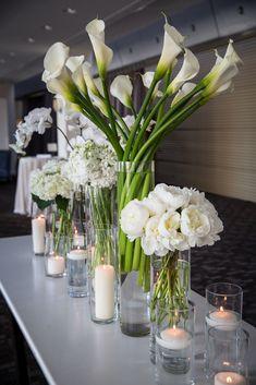 Modern White Reception Flowers | mkPhoto https://www.theknot.com/marketplace/mkphoto-west-chester-pa-246928 | Rebecca Richman | Petals Lane https://www.theknot.com/marketplace/petals-lane-philadelphia-pa-289171
