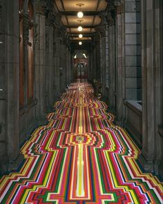 Huge, bright, geometric floor designs made with ordinary vinyl tape...