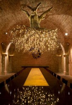 """Designed for the grandeur caves of a winery, the Chilean Red chandelier was created by sculptor Donald Lipski in collaboration with fellow designer Jonquil LeMaster."""