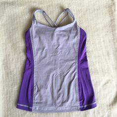 Lululemon Purple Top Size 6 Preowned Lululemon Purple Top Size 6. No size tag. Built in bra, no pads included. Please look at pictures for better reference. Happy shopping! lululemon athletica Tops Tank Tops