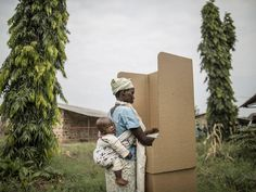 A Burundian woman votes in a polling station in the Kinama neighborhood in Bujumbura. Voting in Burundi's controversial elections opened despite a string of grenade attacks on polling stations, the latest in weeks of violence sparked by the president's defiant bid for a third term