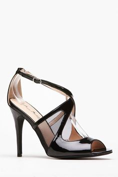 Women's Fashion High Heels :    Gotta love a chic simple black heel! It features a padded insole, peep toe front, criss cross ankle strap with adjustable side buckle, mesh cut out sides, and a faux patent leather exterior. Take this pair of heels out with your favorite fitted jumpsuit for... - #HighHeels https://youfashion.net/shoes/high-heels/trendy-womens-high-heels-gotta-love-a-chic-simple-black-heel-it-features-a-padded-insole-peep-toe-front/