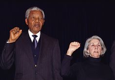 Nelson Mandela and Nadine Gordimer sing the National Liberation Anthem at the Ghandi Memorial in Johannesburg, 1993.