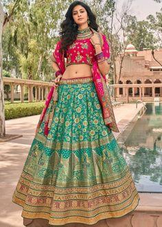 #green #woven #banarasi #silk #bridal #lehenga #choli #dupatta #designs # traditional #indian #outfits #gorgeous #wedding #look #ootd #new #arrival #womenswear #online #shopping Lehenga Choli Latest, Pakistani Lehenga, Bridal Lehenga Choli, Silk Lehenga, Silk Dupatta, Blue Silk Saree, Indian Silk Sarees, Salwar Kameez, Kurti