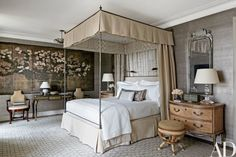 The master bedroom features armchairs by Frederick P. Victoria & Son and a Louis XVI bureau plat   archdigest.com