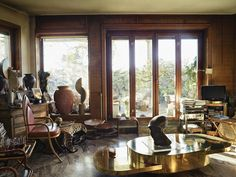 The living room of Crespi's Milan apartment, with such works as her iconic Ellisse coffee...