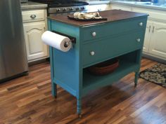 upcycled dresser made into kitchen island! replace the top with a cutting board or smoother surface.