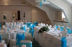 White Chair Covers with Bright Blue Sash