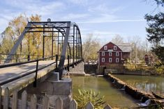 ROGERS, ARKANSAS  The bridge you cross to get to War Eagle Mill is both historic and totally gorgeous . . .
