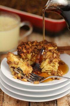 This Eggnog Cinnamon Roll French Toast Casserole with a Brown Sugar Walnut Crumble makes for a fabulous Sunday breakfast.  Delicious and richly flavoured with eggnog and warming spices, it is topped with a satisfyingly crunchy layer of Brown Sugar Walnut Crumble.
