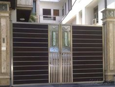 Stainless steel gate design gates and doors design series are supplied with a surface by l ribbed or with panels of solid wood species. House Main Gates Design, Door Gate Design, Entrance Design, Entrance Gates, House Design, Fence Doors, Fence Design, Wall Design, Latest Main Gate Designs