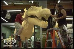 Creature creators Trevor L. Hensley and Joey Orosco sculpt detail into the milled-foam puzzle pieces of the giant Spinosaurus created by Stan Winston Studio for JURASSIC PARK III.