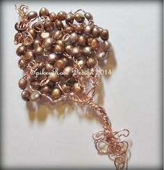 Tree of Life pendant in non-tarnish rose gold colour wire and lovely mocha colour seed pearls.
