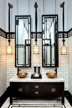 We're inspired by the sense of the exotic and the dramatically dark details of this beautiful bathroom. A marble-topped timber vanity sets the scene while the hanging pendant lights soften the solid palette alongside warm copper basins. This stunning room can be found at The Siam Hotel. #bathroom #luxury #travel