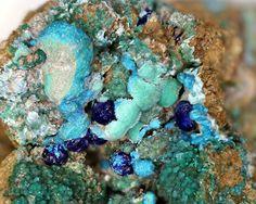 Parnauite, Cu9(AsO4)2(SO4)(OH)10•7(H2O), Prehistoric dump, Schwarzleo District, Schwarzleograben, Hütten, Leogang, Saalfelden, Salzburg, Austria.  Light blue globular crystals with needle-like structure only partially coat the Strashimirite with malachite and azurite. Fov 7.5 mm. Collection/Copyright: Manfred Früchtl