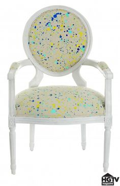 Splatter paint drop cloth and use to reupholster (of make throw pillows?)